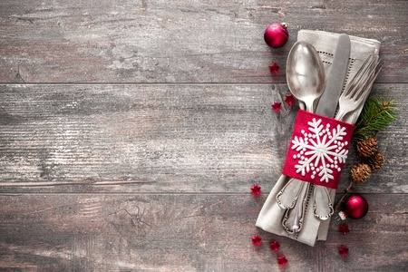 Christmas table place setting. Holidays background. Stock Photo