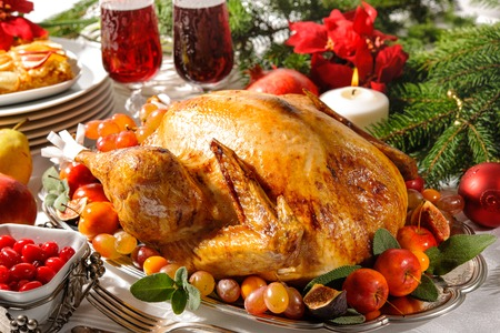 feasts: Roasted turkey on holiday table with candles Stock Photo