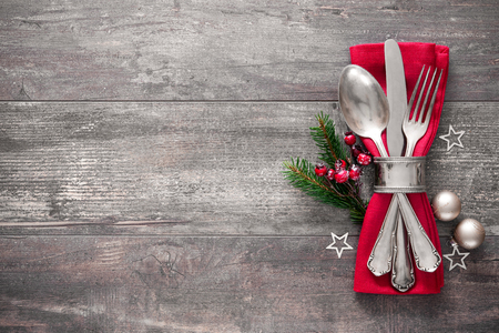 eating dinner: Christmas table place setting. Holidays background Stock Photo