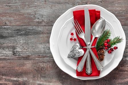 クリスマスのテーブルの場所の設定。休日の背景 写真素材