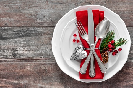Christmas table place setting. Holidays background Stockfoto