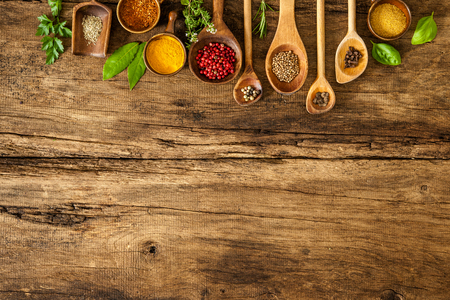 writing table: Various colorful spices on wooden table
