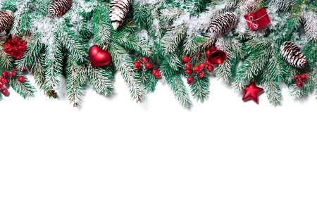feliz navidad: Christmas Border. Tree branches with baubles, stars, snowflakes isolated on white