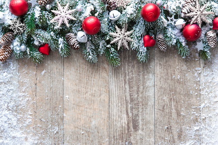 snowflake snow: Christmas background with decorations and snow on wooden board Stock Photo