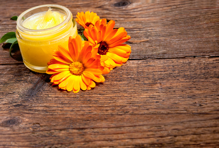 ointment: Homemade calendula ointment on wooden table
