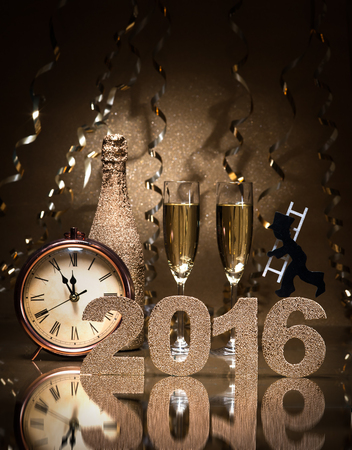 chimney sweep: New Years Eve celebration background with pair of flutes, bottle of champagne, clock and a chimney sweep as lucky charm