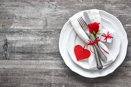 rose: Valentines day table place setting. Holidays background Stock Photo