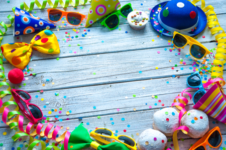 carnival: Colorful carnival background with party accessory, streamers and confetti