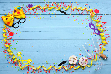 new year eve confetti: Colorful Carnival background party accessory, streamers, confetti, ribbon, donuts and champagne glasses