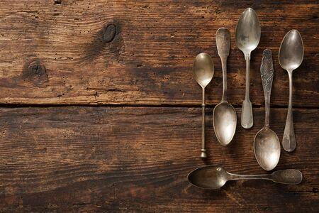 flatware: Vintage metal spoons on wooden table