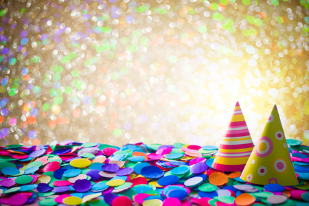 Carnival background with confetti and party hats