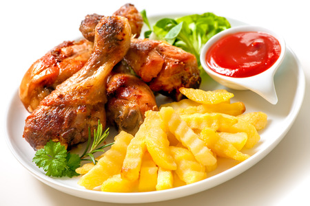 Grilled chicken legs with french fries and ketchup