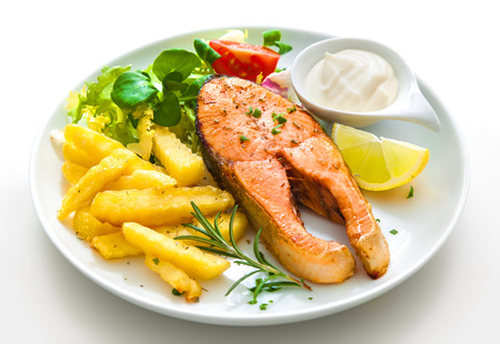 fish plate: Fried salmon with french fries and vegetables