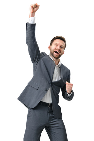 suit man: Excited businessman celebration success. Isolated on white background