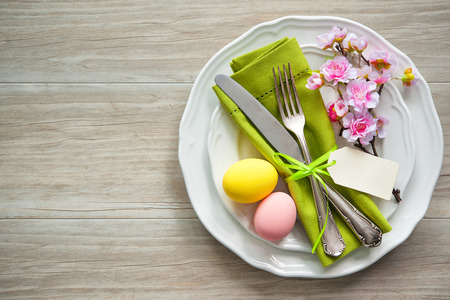 party table: Easter table setting with spring flowers and cutlery. Holidays background