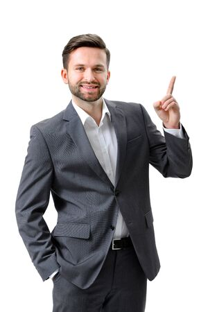 Handsome young businessman pointing to something photo