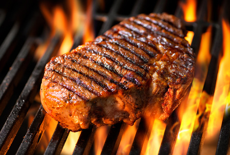 barbecue: Beef steak on the grill with flames