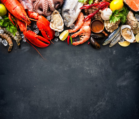 Shellfish plate of crustacean seafood with fresh lobster, mussels, oysters as an ocean gourmet dinner background Stockfoto