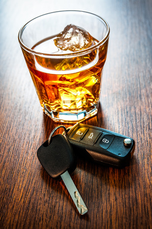 dwi: Whiskey with car keys concept for drinking and driving