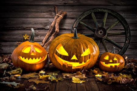 burning: Halloween pumpkin head jack lantern with burning candles