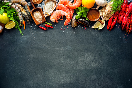 Shellfish plate of crustacean seafood with shrimps, mussels, oysters as an ocean gourmet dinner background Standard-Bild