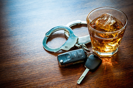Whiskey with car keys and handcuffs concept for drinking and driving 스톡 콘텐츠