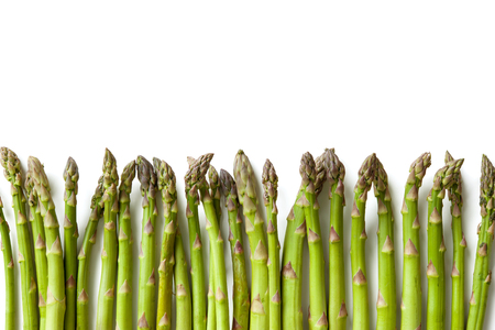 Delicious fresh asparagus on white background Imagens