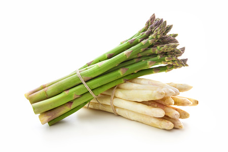Delicious fresh asparagus on white background Standard-Bild