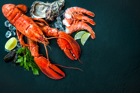 crustacean: Shellfish plate of crustacean seafood with fresh lobster, mussels, shrimps, oysters as an ocean gourmet dinner background Stock Photo