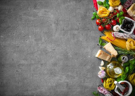 Italian food ingredients on slate background