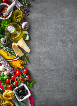 Italian food ingredients on slate background