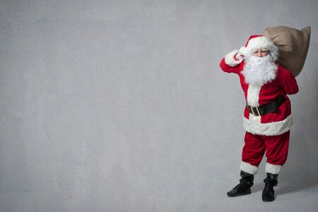 claus: Santa Claus with a big bag of presents Stock Photo