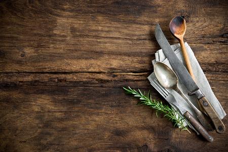 vintage kitchen utensils on wooden table Foto de archivo