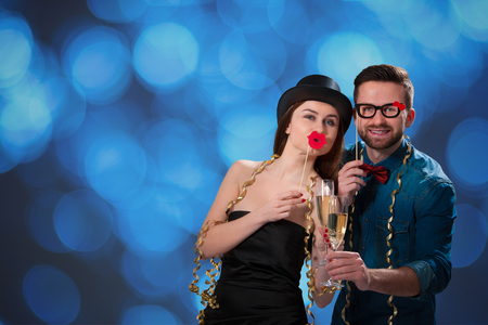 Young couple with champagne flutes celebrating New year's eve and having fun photo