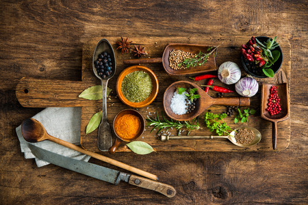 rustic kitchen: Various colorful spices on wooden table
