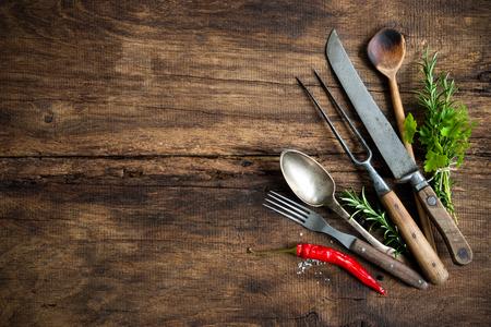vintage kitchen utensils on wooden table Stock Photo