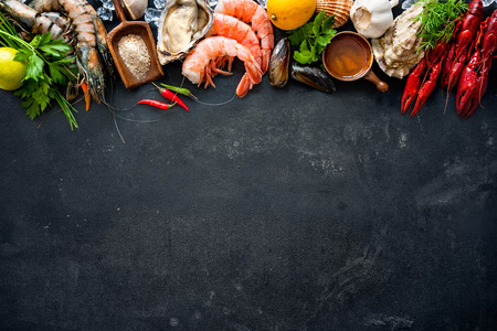 Shellfish plate of crustacean seafood with shrimps, mussels, oysters as an ocean gourmet dinner background Stok Fotoğraf