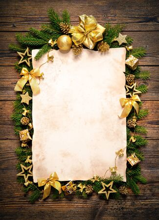 wishlist: Old paper bordering with christmas decoration on wooden background Stock Photo