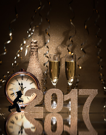 New Years Eve celebration background with pair of flutes, bottle of champagne, clock and a chimney sweep as lucky charm