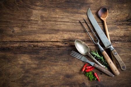 wood board: vintage kitchen utensils on wooden table Stock Photo