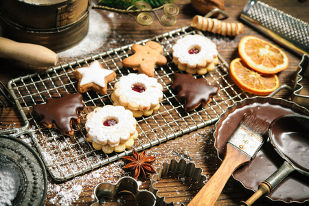 chocolate cookies: Christmas baking background with cookies, cookie cutters, spices and other ingredients