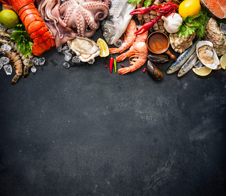 crustacean: Shellfish plate of crustacean seafood with fresh lobster, mussels, oysters as an ocean gourmet dinner background Stock Photo