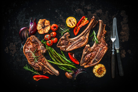 Roasted lamb meat with vegetables on dark background 스톡 콘텐츠