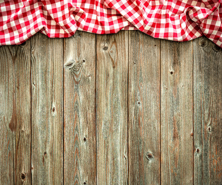 tablecloth: Red checkered tablecloth on wooden table