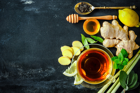 ginger health: Cup of ginger tea with lemon and honey on slate plate Stock Photo