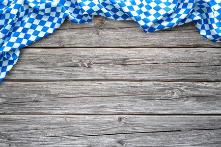 Rustic background for Oktoberfest with bavarian white and blue fabric on wooden Stock Photo