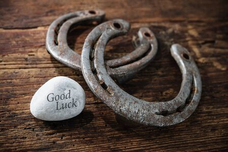 charms: Old horseshoes as lucky charms on wooden background