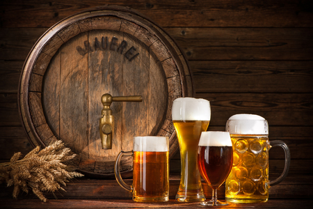 festival: Beer barrel with beer glasses on wooden background