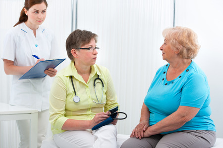 Physician explaining diagnosis to elderly patient at the office