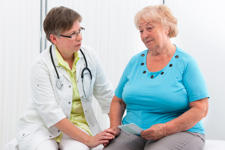 general practice: Physician explaining diagnosis to elderly patient at the office